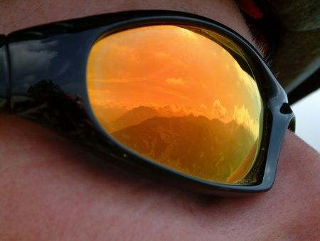 Reflection in mountain bikers glasses Imagens