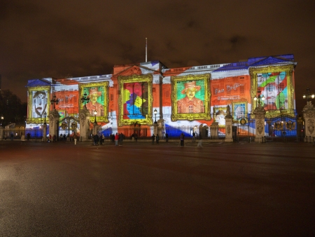 LONDON - APRIL  21 - Buckingham Palace projection shows the portrait of Queen Elizabeth and self-portraits of young people in the art project Face   Britain on April 21, 2012 in London