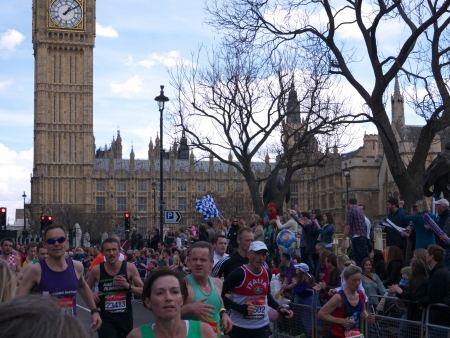 London, United Kingdom - April 22, 2012  Runners participating in the London Marathon 2012 passing The Houses of Parliament and Big Ben