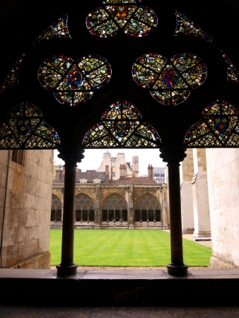 LONDON - APRIL 21  Courtyard of Westminster Abbey with stained glass windows in the cloister on April 21, 2012 in London  The abbey is the venue for many royal occasions such as wedding, coronations and burials