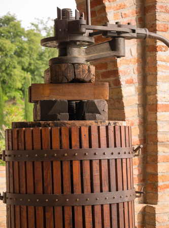 Vintage oil press and wooden barrel photo