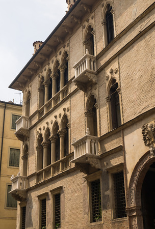 Facade of palace in Vicenza, Italy, with typical balcony with columns photo