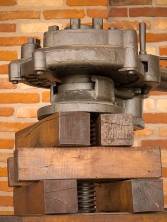 Detail of vintage oil press photo