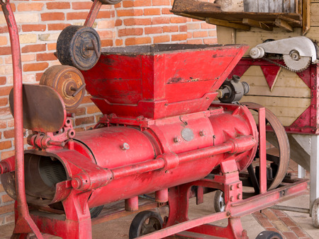 the old days: Metal vintage grape crusher as used in the old days Stock Photo