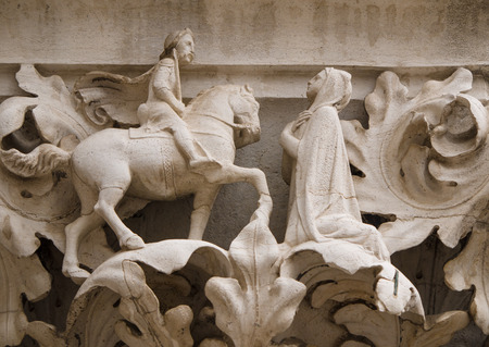 doges: Column capital at Doges Palace in Venice shows architectural details of a knight and his lady Stock Photo