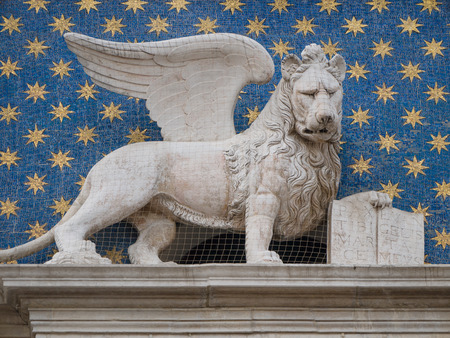 The winged lion of St. Mark is the symbol of the city of Venice in Italy and is often seen holding a book representing power, wisdom and justice