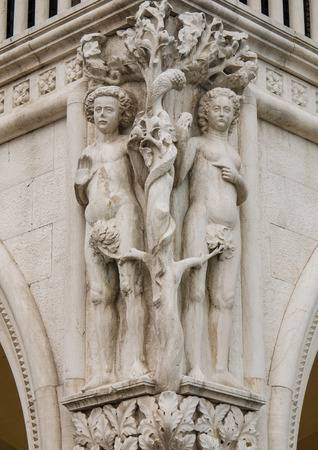 Column capital at Doges Palace in Venice shows architectural details of a Adam and Eve photo