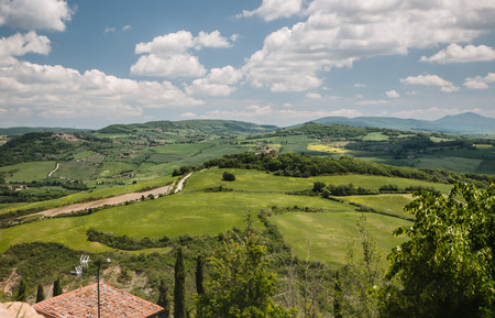 val dorcia: Panoramic view on fields in the Tuscan landscape of the Val dOrcia overcast by dramatic clouds Stock Photo