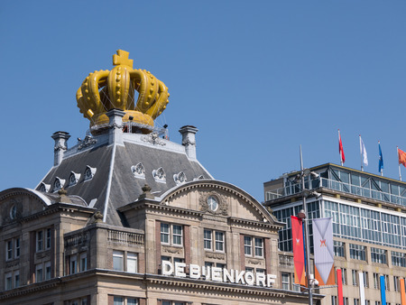 beatrix: AMSTERDAM - APRIL 30: A building in the city of Amsterdam has been crowned with a huge crown to commemorate the inauguration of King Willem-Alexander in Amsterdam on April 30, 2013.