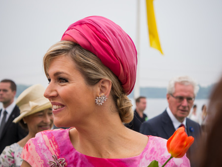 orange nassau: ALMERE, THE NETHERLANDS - JUNE 19, 2013: Queen Maxima of the Netherlands shakes hands with the general public during an official introductory visit to the city of Almere in the province of Flevoland on June 19, 2013 in Almere, the Netherlands.