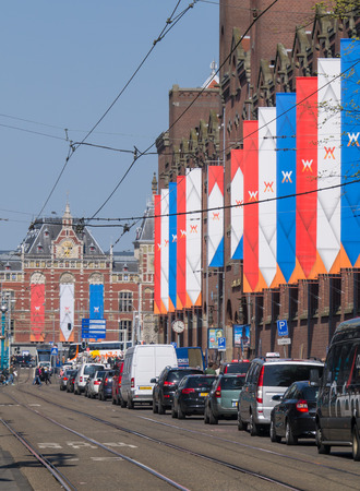 AMSTERDAM - APRIL 30: Buildings in the city of Amsterdam have been decorated with flags and banners to commemorate the inauguration of King Willem-Alexander in Amsterdam on April 30, 2013.