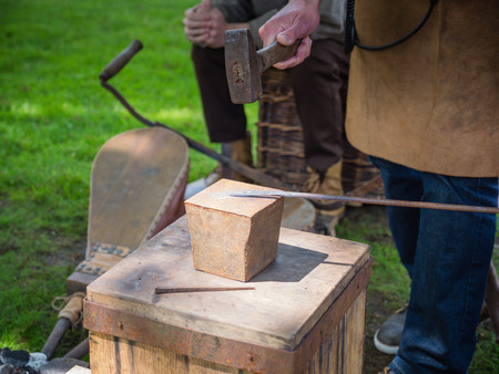 Blacksmith demonstrating his craft photo