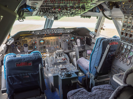 altimeter: View inside the cockpit of a jumbo jet airliner