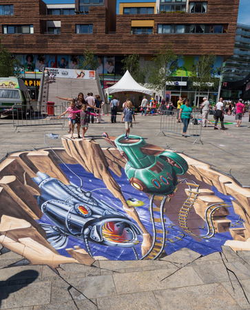 ALMERE, NETHERLANDS - JUNE 30: Street art showing the power of 3D optical illusion during the annual Steet Art Festival held in the streets of the city of Almere on June 30, 2013