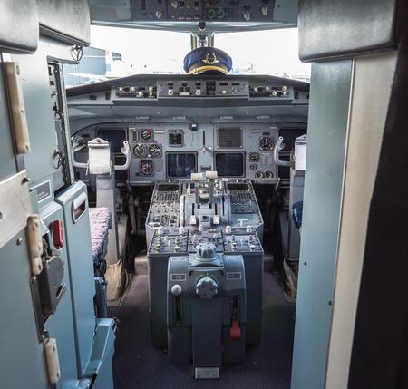 Inside the cockpit of a vintage Fokker 100  airliner