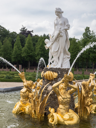 Fountain representing mythological goddes Venus and cherub at royal palace Het Loo, the Netherlands