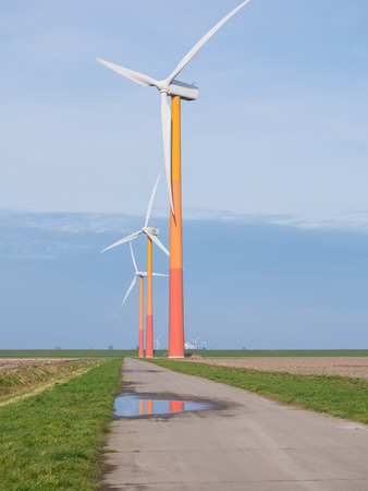 polder: Brightly colored wind turbine in the flat polder lands in the province of Flevoland, the Netherlands
