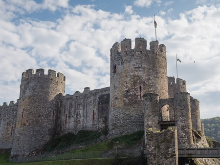 king edward: Exterior of massive Conwy Castle in Wales built by king Edward I as one of the fortifications during the conquest of Wales in the 13th Century