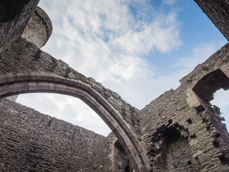 king edward: View to the sky from inside massive Conwy Castle in Wales built by king Edward I as one of the fortifications during the conquest of Wales in the 13th Century