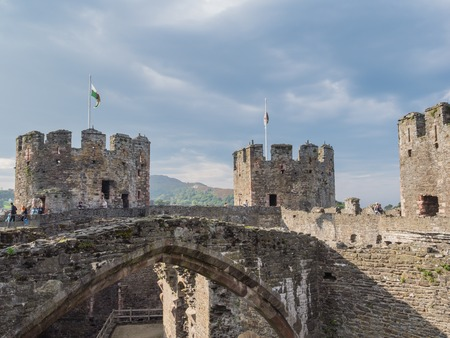 king edward: CONWY, WALES - 28 SEPTEMBER 2013: View on the battlements of massive Conwy Castle in Wales built by king Edward I as one of the fortifications during the conquest of Wales in the 13th Century