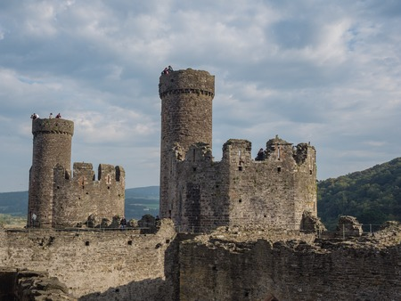 estuary: CONWY, WALES - 28 SEPTEMBER 2013: View on the battlements of massive Conwy Castle in Wales built by king Edward I as one of the fortifications during the conquest of Wales in the 13th Century