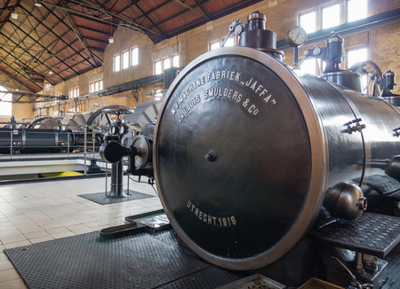 lemmer: LEMMER, NETHERLANDS - 2 MARCH 2014  Inside the machine room of the historic Wouda steam pumping station from 1920  It is the largest of its kind ever built and is still in operation  It pumps away excess water in the province of Friesland