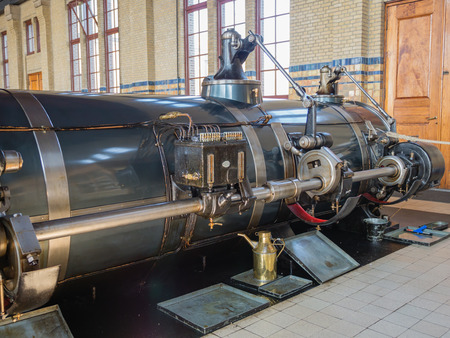 LEMMER, NETHERLANDS - 2 MARCH 2014  Inside the machine room of the historic Wouda steam pumping station from 1920  It is the largest of its kind ever built and is still in operation  It pumps away excess water in the province of Friesland