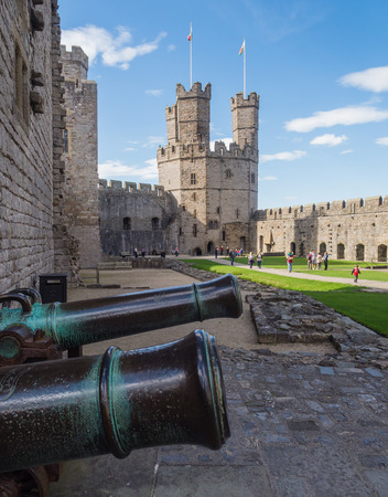 queen elizabeth ii: CAERNARFON, WALES - 29 SEPTEMBER 2013: Caernarfon Castle, well-known for its polygonal towers, dates from the 13th century.  In 1969 Prince Charles was invested here as Prince of Wales by HM Queen Elizabeth II. Editorial