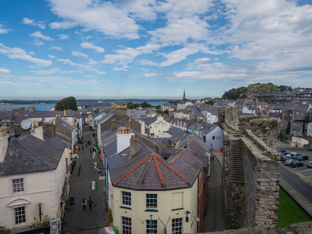 hm: CAERNARFON, WALES - 29 SEPTEMBER 2013: View on the town of Caernarfon from the 13th century castle, well-known for its polygonal towers.  In 1969 Prince Charles was invested here as Prince of Wales by HM Queen Elizabeth II.