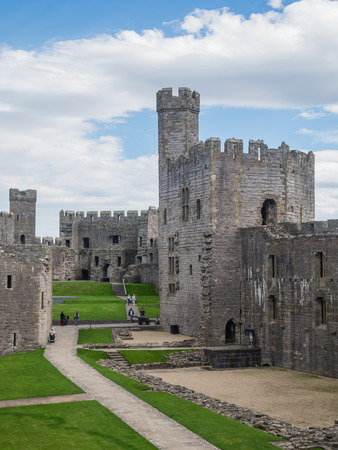 norman castle: CAERNARFON, WALES - 29 SEPTEMBER 2013: Caernarfon Castle, well-known for its polygonal towers, dates from the 13th century.  In 1969 Prince Charles was invested here as Prince of Wales by HM Queen Elizabeth II. Editorial