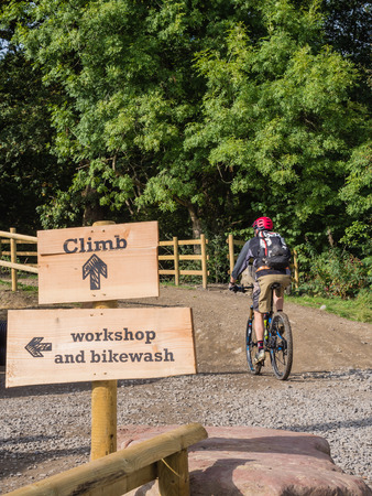 MERTHYR TYDFIL, WALES - 25 SEPTEMBER 2013: Mountain biker at the start of a trail in Mountain Bike Bark Wales, the UK's only purpose built bike park with suitable trails for beginners and pros.