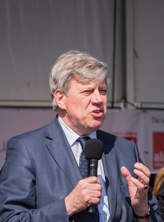 ALMERE, NETHERLANDS - 12 APRIL 2014: Dutch Minister of Security and Justice, Ivo Opstelten,  hold a speech during the first National Security Day held in the city of Almere