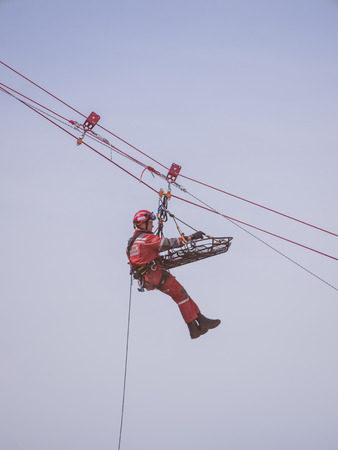 descender: ALMERE, NETHERLANDS - 12 APRIL 2014: Rescue workers during an abseiling demonstration at the first National Security Day held in the city of Almere