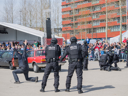 swat: ALMERE, NETHERLANDS - 12 APRIL 2014: SWAT team during a demonstration of an enacted robbery at the first National Security Day held in the city of Almere