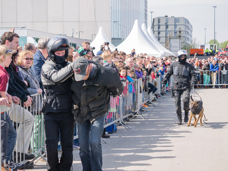 almere: ALMERE, NETHERLANDS - 12 APRIL 2014: SWAT team during a demonstration of an enacted robbery at the first National Security Day held in the city of Almere