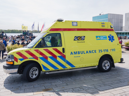 ALMERE, NETHERLANDS - 12 APRIL 2014: Ambulance on the scende during an enacted emergency scene at the first National Security Day held in the city of Almere