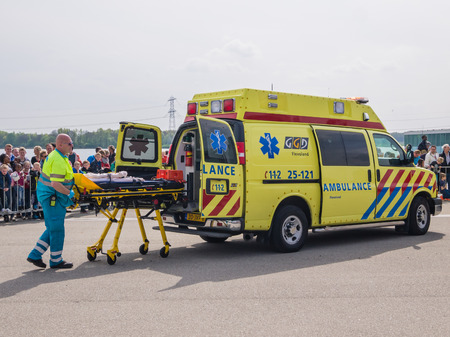 ALMERE, NETHERLANDS - 12 APRIL 2014: Medical services at work in an enacted emergency scene during the first National Security Day held in the city of Almere