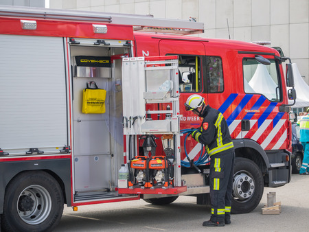 ALMERE, NETHERLANDS - 12 APRIL 2014: Firefighters at work in an enacted emergency scene during the first National Security Day held in the city of Almere