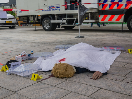 almere: ALMERE, NETHERLANDS - 12 APRIL 2014: Dummy dead body in a crime scene during an enactment at the first National Security Day held in the city of Almere