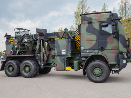 ALMERE, NETHERLANDS - 23 APRIL 2014: Dutch military tow truck on display during the National Army Day in Almere can be inspected by the general public at close range Publikacyjne