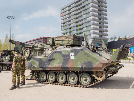 close range: ALMERE, NETHERLANDS - 23 APRIL 2014: Dutch military armored fighting vehicle on display during the National Army Day in Almere can be inspected by the general public at close range