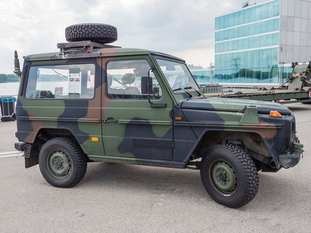 ALMERE, NETHERLANDS - 23 APRIL 2014: Dutch military all-terrain vehicle on display during the National Army Day in Almere can be inspected by the general public at close range Éditoriale