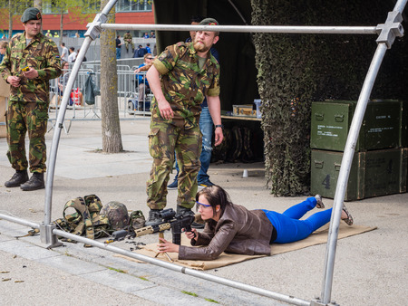 weaponry: ALMERE, NETHERLANDS - 23 APRIL 2014: On National Army Day kids and adults of all ages  are allowed to try out weaponry with dumy bullets under guidance of the military in Almere Editorial