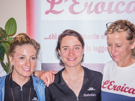 historic world event: GAIOLE IN CHIANTI, ITALY - 5 OCT. 2014: Three female world champions, Pauline Ferrand-Prevot, Marianne Vos and Alessandra Cappellotto are taking part in LEroica, a touristic and historic cycling event for owners of vintage bicycles who ride a tour in vi