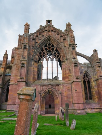 abbey ruins abbey: The ruins of pink colored Melrose Abbey in the Scottisch Borders region in Scotland
