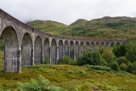 the jacobite: Glenfinnan railway viaduct in the Western Highlanda, Scotland