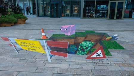 street painting: ALMERE, NETHERLANDS - 27 OCT. 2015: Street painting by an unknown artists shows the power of 3D optical illusion. Once a year the city of Almere allows artists to make paintings on the streets