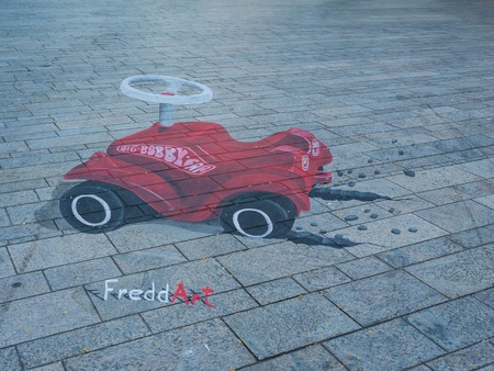 ALMERE, NETHERLANDS - 27 OCT. 2015: Street painting by an unknown artists shows the power of 3D optical illusion. Once a year the city of Almere allows artists to make paintings on the streets