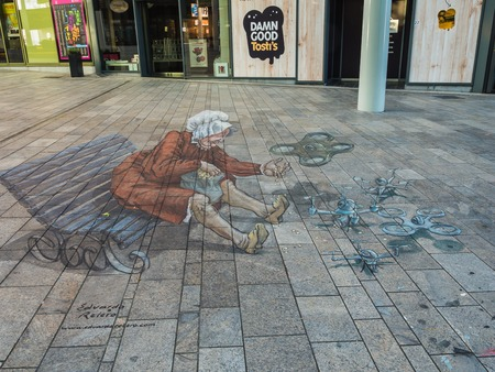 ALMERE, NETHERLANDS - 27 OCT. 2015: Street art by an unknown artist shows the power of 3D optical illusion. Once a year the city of Almere allows artists to make paintings on the streets