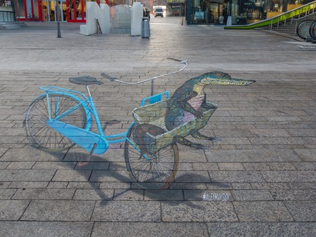 street painting: ALMERE, NETHERLANDS - 27 OCT. 2015: Painting by unknown artist shows the power of 3D optical illusion of a street painting. Once a year the city allows artists to make paintings on the streets Editorial